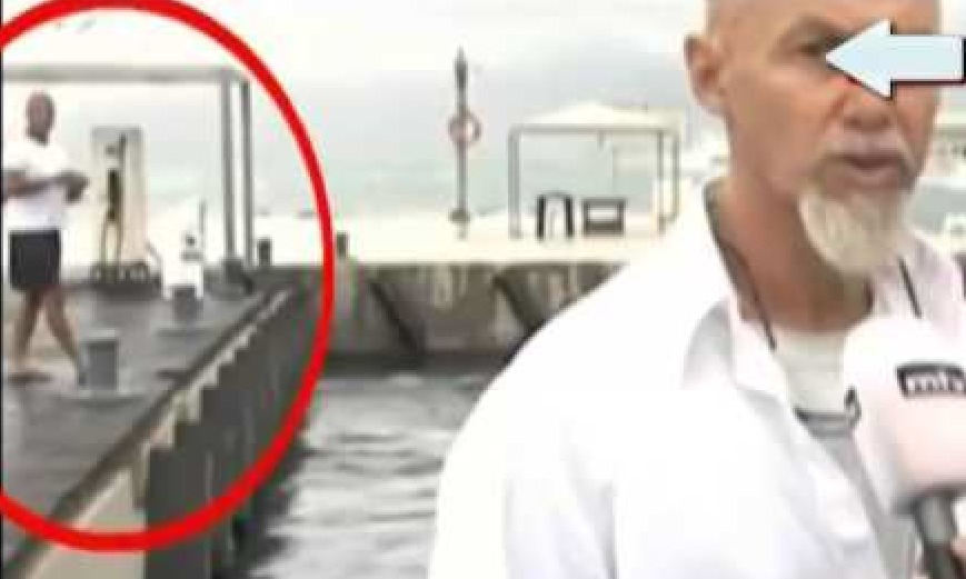 """TVの中継中に偶然映った""""自撮りにしようとして失敗して海に落下する男""""がジワジワくるwww"""