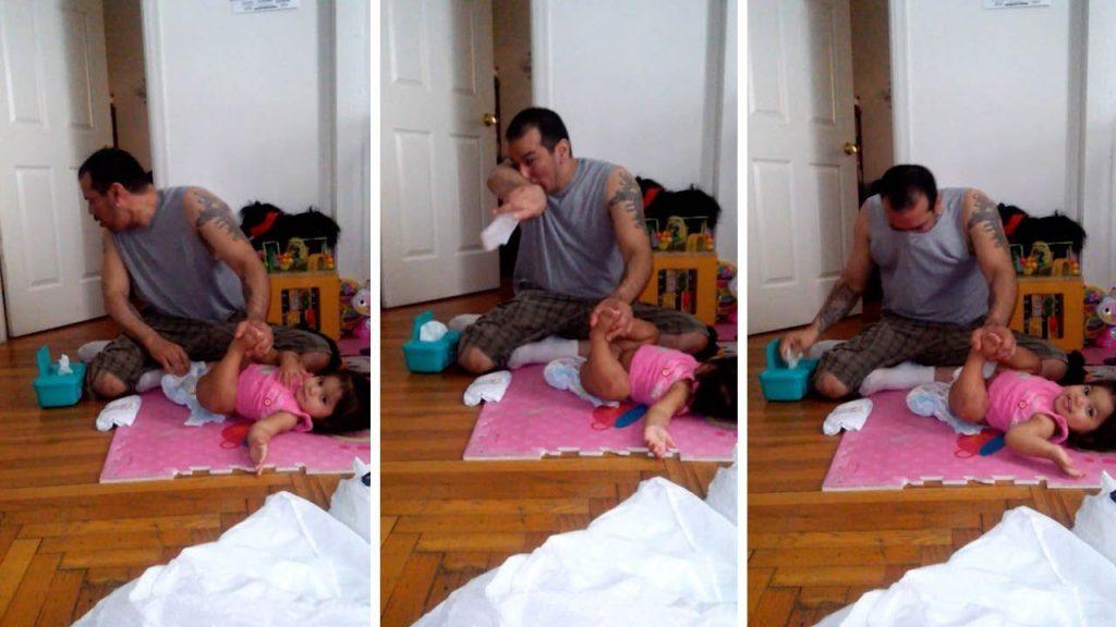 初めて娘のオムツ替えをする強面なパパ。吐きそうになりながらも頑張る姿が微笑ましい^^