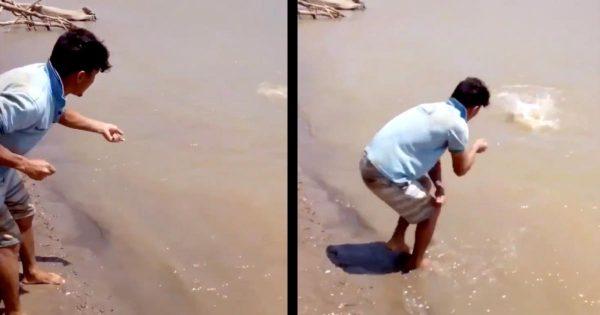川で釣りをする男性。思いもよらぬ大物が釣れてしまう動画が面白いと世界中で話題に!